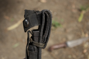 Folding the belt loop back down the sheath and securing with gutted 550.