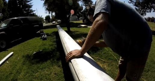 Justin sanding the mast